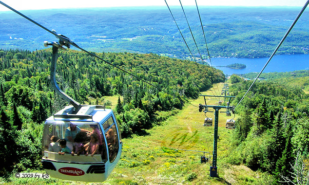 Ride on panoramic gondola to the top of the highest peak in the Laurentians