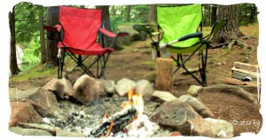 Camping chairs, axe, firewood, campfire