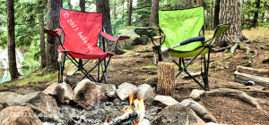 Camping site in forest with camp fire